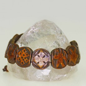 Bracelet of dark brown colored bone