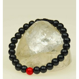 Onyx bracelet with a red ball coral