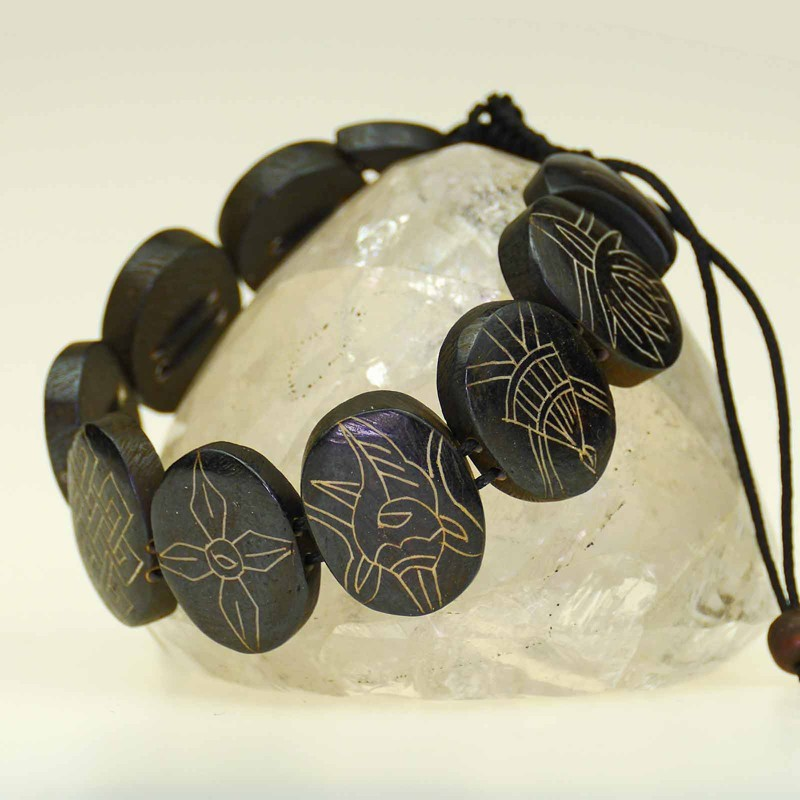 Beautiful bracelet of black-brown colored bone
