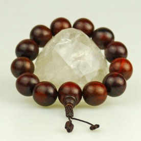 Ball bracelet from dark wood