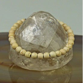 Bracelet with bleached bones in lens shape