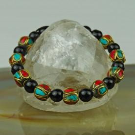 Armband aus schwarzem Onyx und Messing